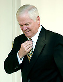 Washington, D.C. - January 3, 2007 -- United States Secretary of Defense Robert Gates adjusts his tie as he walks towards the Rose Garden where U.S.  President George W. Bush would make a statement at the White House on Wednesday, January 3, 2007, in Washington, D.C.  In his remarks the President called on the new Democratic leaders in Congress to work with his administration.<br /> Credit: Ron Sachs / CNP