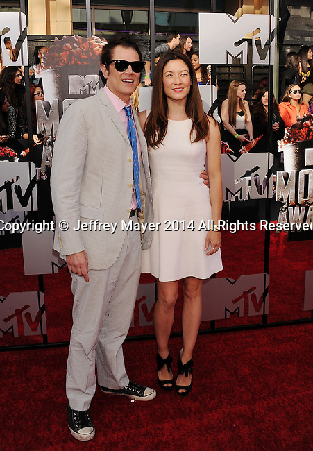 LOS ANGELES, CA- APRIL 13: Actor Johnny Knoxville (L) and director Naomi Nelson attend the 2014 MTV Movie Awards at Nokia Theatre L.A. Live on April 13, 2014 in Los Angeles, California.