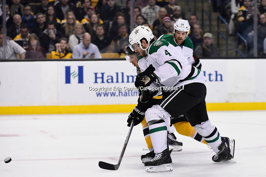 February 10, 2015 - Boston, Massachusetts, U.S. - Boston Bruins left wing Brad Marchand (63) and Dallas Stars defenseman Jason Demers (4) race to the puck during the NHL match between the Dallas Stars and the Boston Bruins held at TD Garden in Boston Massachusetts. Dallas defeated Boston 5-3 in regulation time. Eric Canha/CSM