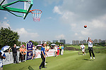Mark O'Meara throws a basketball during the World Celebrity Pro-Am 2016 Mission Hills China Golf Tournament on 23 October 2016, in Haikou, Hainan province, China. Photo by Weixiang Lim / Power Sport Images
