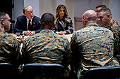 United States President Donald J. Trump, left, and First Lady Melania Trump, center, listen while speaking to Marines at Marine Barracks in Washington, D.C., U.S, on Thursday, Nov. 15, 2018. President Trump and the First Lady are meeting with Marines who responded to a building fire at the Arthur Capper Public Housing complex on September 9, 2018.<br /> Credit: Andrew Harrer / Pool via CNP