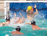 Goalie Adam Florsheim '17 blocks a shot. The Occidental College men's water polo team plays against Claremont-Mudd-Scripps in Taylor Pool on Oct. 25, 2014. (Photo by Marc Campos, Occidental College Photographer)