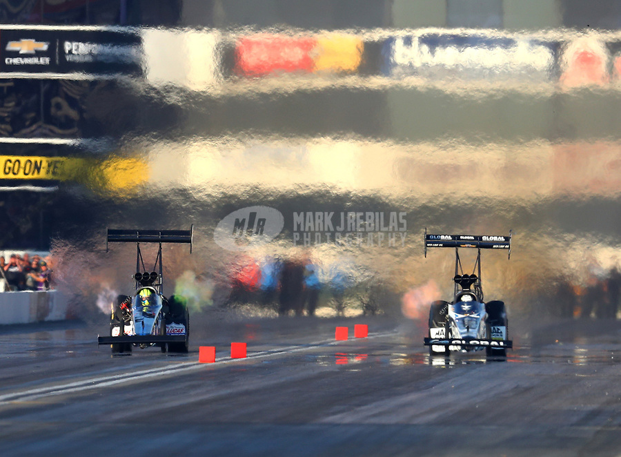 Nov 11, 2017; Pomona, CA, USA; NHRA top fuel driver Blake Alexander (left) races alongside Shawn Langdon during qualifying for the Auto Club Finals at Auto Club Raceway at Pomona. Mandatory Credit: Mark J. Rebilas-USA TODAY Sports