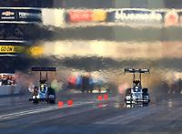 Nov 11, 2017; Pomona, CA, USA; NHRA top fuel driver Blake Alexander (left) races alongside Shawn Langdon during qualifying for the Auto Club Finals at Auto Club Raceway at Pomona. Mandatory Credit: Mark J. Rebilas-USA TODAY Sports