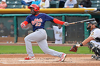 Jermaine Curtis (23) of the Memphis Redbirds at bat against the Salt Lake Bees at Smith's Ballpark on June 18, 2014 in Salt Lake City, Utah.  (Stephen Smith/Four Seam Images)