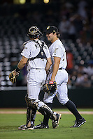 Charlotte Knights relief pitcher Tommy Kahnle (23) is congratulated by catcher Vinny Rottino (4) after closing out the win over the Pawtucket Red Sox at BB&T BallPark on July 6, 2016 in Charlotte, North Carolina.  The Knights defeated the Red Sox 8-6.  (Brian Westerholt/Four Seam Images)