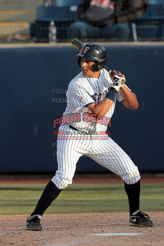 Carlos Lopez #17 of the Cal State Fullerton Titans bats against the Loyola Marymount Lions at Goodwin Field on February 29, 2012 in Fullerton,California. Cal State Fullerton defeated LMU 6-2.(Larry Goren/Four Seam Images)
