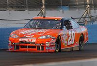 Apr 19, 2007; Avondale, AZ, USA; Nascar Nextel Cup Series driver Tony Stewart (20) during qualifying for the Subway Fresh Fit 500 at Phoenix International Raceway. Mandatory Credit: Mark J. Rebilas