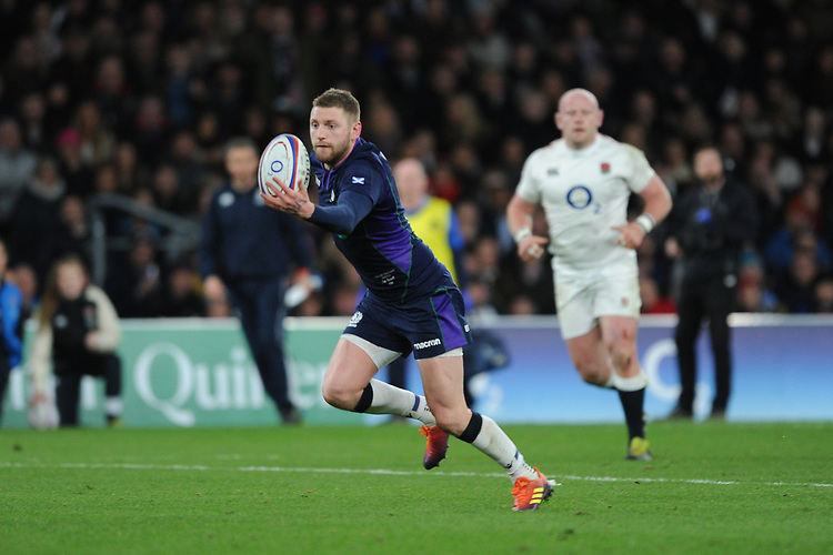 Finn Russell of Scotland juggles a loose ball on his way to running in a try during the Guinness Six Nations Calcutta Cup match between England and Scotland at Twickenham Stadium on Saturday 16th March 2019 (Photo by Rob Munro/Stewart Communications)