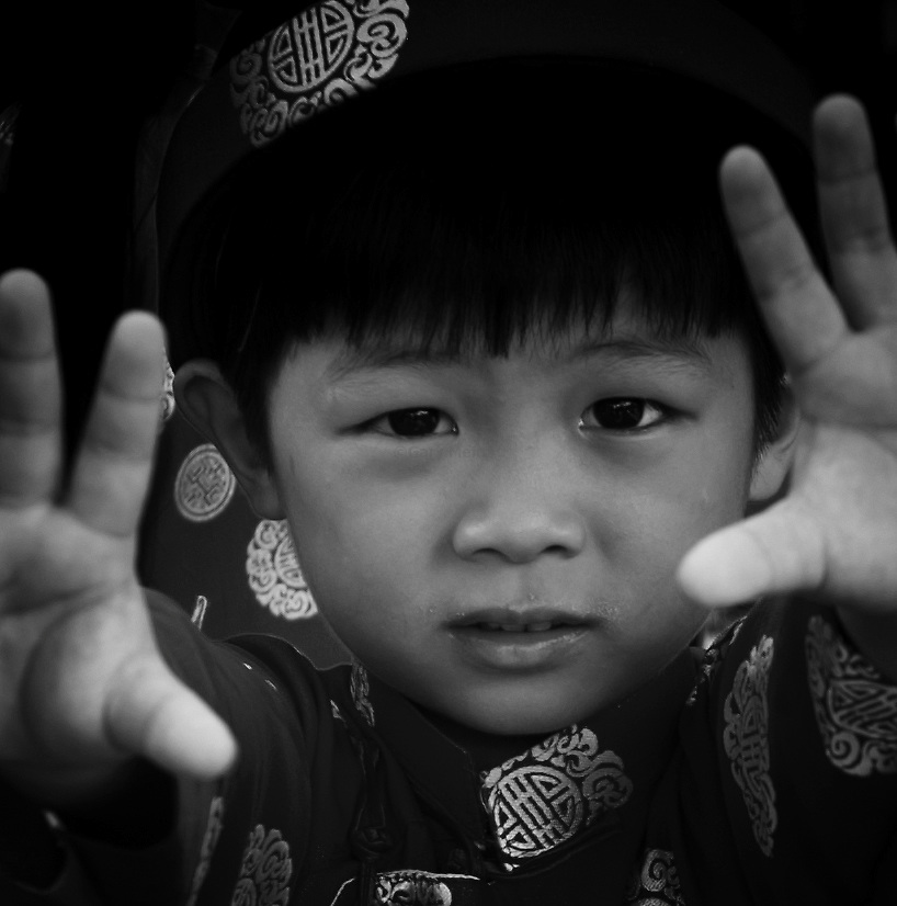 Young boy dressed for TET pictures