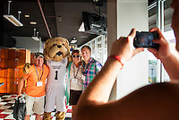 Mark and Julie Simons of Franklin, Tennessee, and their son Luke, an incoming freshman who plans to major in mechanical engineering, pose with Bully after enjoying a barbecue lunch in Davis Wade Stadium during Orientation 2015.<br />