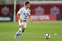 TORONTO, ON - OCTOBER 15: Nick Lima #16 of the United States moves with the ball during a game between Canada and USMNT at BMO Field on October 15, 2019 in Toronto, Canada.