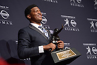 Jameis Winston poses with the 2013 Heisman Memorial Trophy. Winston became the second freshman in Heisman Trophy history to win the award. As quarterback of the Florida State Seminoles, he led the team to an undefeated season and the ACC championship.  (Photo by Don Baxter/Media Images International)