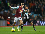 Jack Grealish of Aston Villa tackled by DeAndre Yedlin of Newcastle United during the Premier League match at Villa Park, Birmingham. Picture date: 25th November 2019. Picture credit should read: Darren Staples/Sportimage