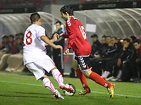 Aghvan Papikyan takes on Florian Gudit in the Armenia v Switzerland UEFA European Under-19 Championship Qualifying Round match at New Douglas Park, Hamilton on 11.10.12.