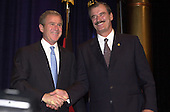 United States President George W. Bush, left, and President Vicente Fox of Mexico, right, shake hands as they arrive to speak at the American Jewish Committee Annual Dinner at the National Building Museum in Washington, D.C. on May 3, 2001..Credit: Ron Sachs / Pool via CNP..