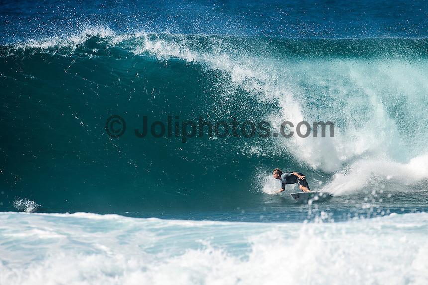 Backdoor, Oahu/Hawaii (Friday, December 12, 2014) Tom Curren (USA) surfing Backdoor.-  Photo: joliphotos.com