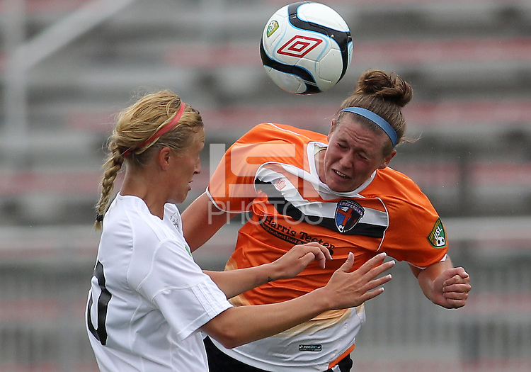 BOYDS, MARYLAND - July 21, 2012:  Amanda Naeher (4) of Charlotte Lady Eagles heads away from Kelly Eagan (20) of the Long Island Roughriders during a W League Eastern Conference Championship semi final match at Maryland Soccerplex, in Boyds, Maryland on July 21.