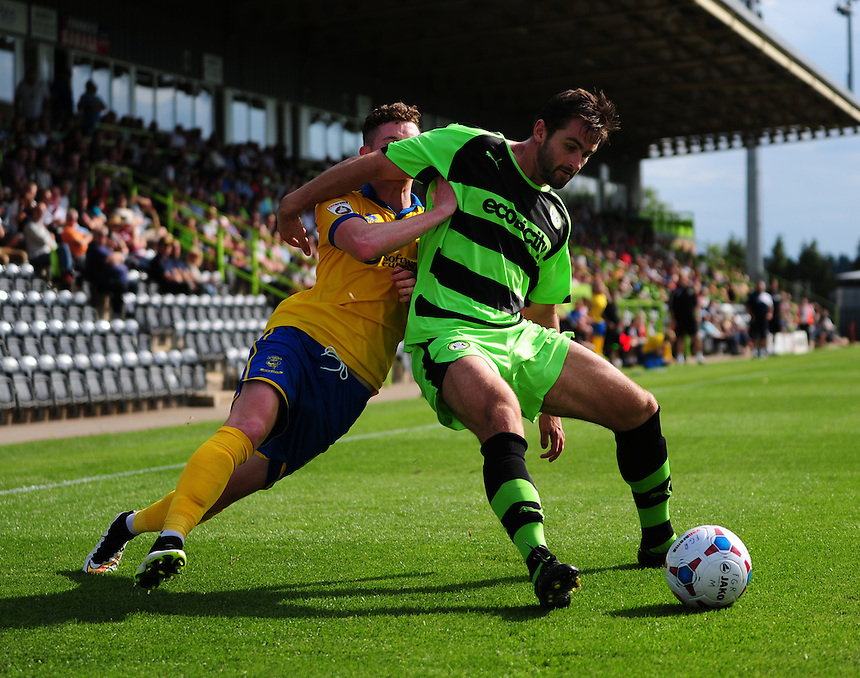 Lincoln City's Conner Robinson vies for possession with Forest Green Rovers' Aarran Racine<br /> <br /> Photographer Andrew Vaughan/CameraSport<br /> <br /> Football - Vanarama National League - Forest Green Rovers v Lincoln - Saturday 22nd August 2015 - The New Lawn - Nailsworth<br /> <br /> &copy; CameraSport - 43 Linden Ave. Countesthorpe. Leicester. England. LE8 5PG - Tel: +44 (0) 116 277 4147 - admin@camerasport.com - www.camerasport.com