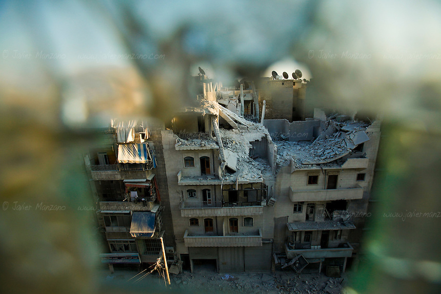 Buildings damaged by aerial bombardment in the city of Aleppo.