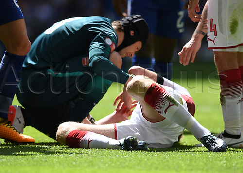 August 6th 2017, Wembley Stadium, London, England; FA Community Shield Final, Arsenal versus Chelsea; Petr Cech of Arsenal with the injured Per Mertesacker of Arsenal