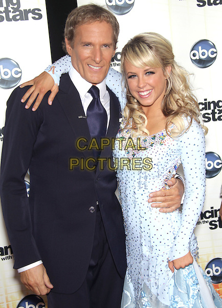 "MICHAEL BOLTON & CHELSIE HIGHTOWER.""Dancing With The Stars"" Season Premiere held at CBS Studios, Los Angeles, CA, USA..September 20th, 2010.half length black suit blue dress arms around waist beads beaded .CAP/RKE/DVS.©DVS/RockinExposures/Capital Pictures."