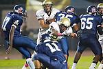 Lawndale, CA 10/21/11 - Marquis Edwards (Leuzinger #17), \le11\ and Okuoma Idah (Peninsula #24) in action during the Peninsula - Leuzinger varsity football game.