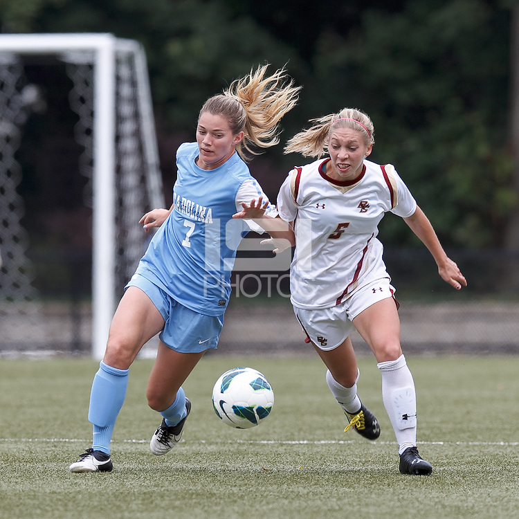 University of North Carolina forward Kealia Ohai (7) and Boston College midfielder Lauren Bernard (5) battle for the ball.   University of North Carolina (blue) defeated Boston College (white), 1-0, at Newton Campus Field, on October 13, 2013.