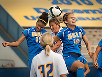 Three Heads are Better than One. Foreward Alissa Sanchez goes head-to-head-to-head with defenders Lucretia Lee and Jenna Belcher during a recent match-up with the #3 UCLA Bruins