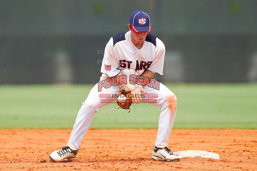 Shortstop Landon Lassiter #6 of STARS has trouble handling a throw at second base against RBI at the 2011 Tournament of Stars at the USA Baseball National Training Center on June 26, 2011 in Cary, North Carolina. (Brian Westerholt/Four Seam Images)