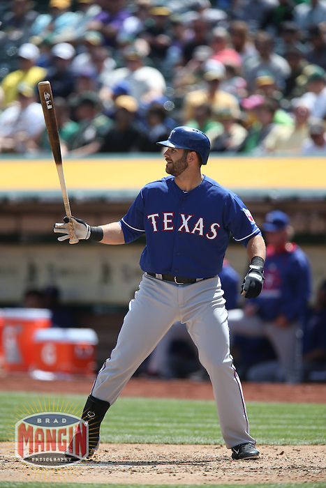 OAKLAND, CA - APRIL 9:  Mitch Moreland #18 of the Texas Rangers bats against the Oakland Athletics during the game at O.co Coliseum on Thursday, April 9, 2015 in Oakland, California. Photo by Brad Mangin