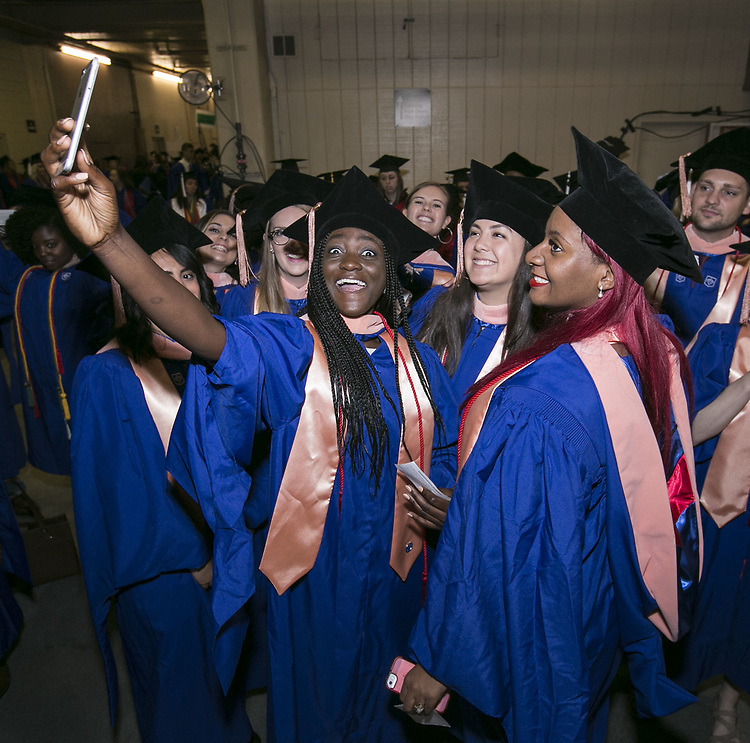 Students from the DePaul University College of Science and Health and College of Liberal Arts and Social Sciences gather backstage for the 119th commencement ceremonies Sunday, June 11, 2017, at the Allstate Arena in Rosemont, IL. (DePaul University/Jamie Moncrief)