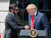 United States President Donald J. Trump, right, shakes hands with Martin Truex Jr., the NASCAR Cup Series champion, left, on the South Lawn of the White House in Washington, DC on Monday, May 21, 2018.  Truex competes full-time in the Monster Energy NASCAR Cup Series for Furniture Row Racing.<br /> Credit: Ron Sachs / CNP