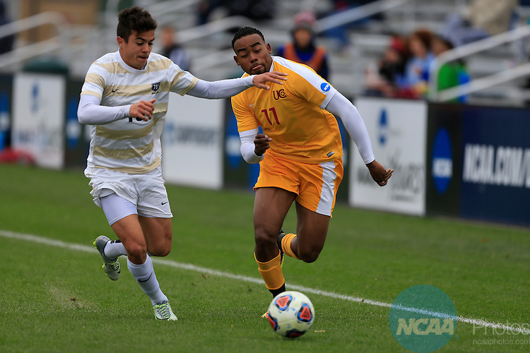KANSAS CITY, MO - DECEMBER 03:  Vicente Munoz (13) of Wingate University and Jermaine Windster (11) of the University of Charleston battle for the ball during the Division II Men's Soccer Championship held at Children's Mercy Victory Field at Swope Soccer Village on December 03, 2016 in Kansas City, Missouri. Wingate beat Charleston 2-0 to win the National Championship. (Photo by Jack Dempsey/NCAA Photos via Getty Images)