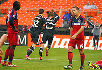 WASHINGTON, D.C - March 29 2014: Perry Kitchen with Bobby Boswell after Kitchen had scored the second goal for D.C United during the D.C. United vs the Chicago Fire MLS match at RFK Stadium, in Washington D.C. The game ended in a 2-2 tie.