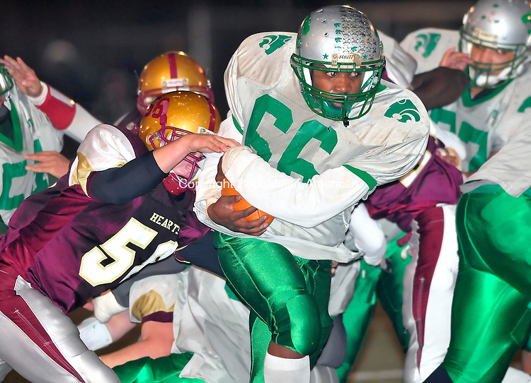 WATERBURY, CT-26 NOVEMBER 2008 --112608JS17--Wilby's Markal Skeen (66) gets tackled by Sacred Heart's Kyle Kenney (58) during their annual Thanksgiving game Wednesday at Municipal Stadium in Waterbury. <br /> Jim Shannon / Republican-American