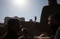 A man stands on the top of a destroyed temple at Kathmandu Durbar Square, Kathmandu, Nepal. May 03, 2015