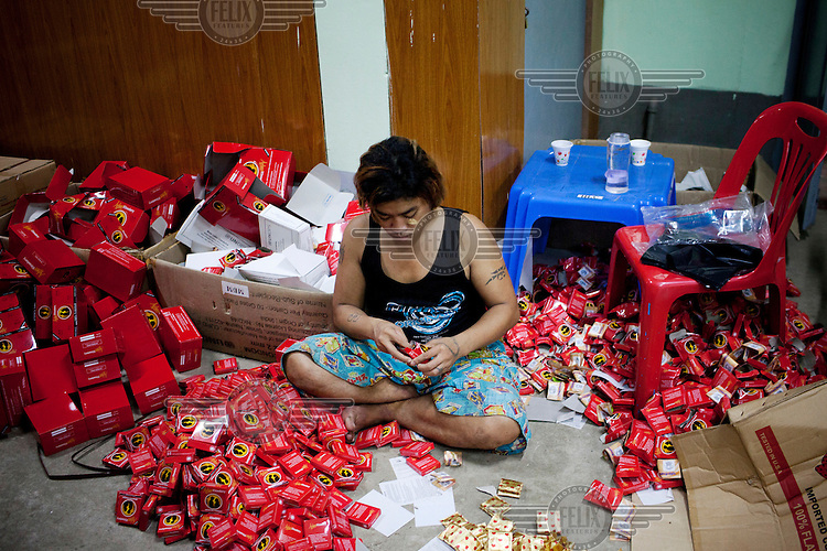 A volunteer prepares packets of condoms and safe sex kits at the MDM (Medecins du Monde) drop in centre in Yangon.