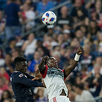 Foxborough, Massachusetts - June 30, 2018: First half action. In a Major League Soccer (MLS) match, New England Revolution (blue/white) vs D.C. United (white/gray/red), at Gillette Stadium.
