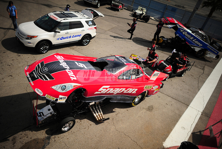 Mar. 30, 2012; Las Vegas, NV, USA: NHRA funny car driver Cruz Pedregon during qualifying for the Summitracing.com Nationals at The Strip in Las Vegas. Mandatory Credit: Mark J. Rebilas-