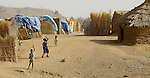 Children fly a kite in a camp for internally displaced families near Zalingei, in Sudan's war-torn Darfur region.