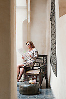 A female guest relaxes in the inner courtyard of the Riad Dar Darma in Marrakech