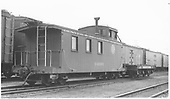End-side angle view of caboose #04990 with idler car.<br /> D&amp;RGW  Alamosa, CO  Taken by Best, Gerald M. - 7/22/1940
