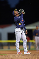 State College Spikes relief pitcher Dewin Perez (29) looks to the sky before taking the mound during a game against the Batavia Muckdogs on June 23, 2016 at Dwyer Stadium in Batavia, New York.  State College defeated Batavia 8-4.  (Mike Janes/Four Seam Images)