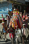 The Dussehra Festival is held in October or early November each year. At this time  Raghunathji (Lord Rama), the presiding Deity of the Kullu Valley, is brought from the Raghunath Temple to Dhalpur Maidan in Kullu. There are around 360 village devtas (gods) and they are carried down from each village to Kullu to pay homage to Lord Raghunathji and to attend the assembly of the gods.The festival celebrates the victory of good over evil, when Lord Rama defeated Ravana the demon king of Lanka. Here the local residents are carrying the murti of Vashisht who was one of the Saptarishis and spiritual master (guru) of Lord Rama..Vashisht, Himachal Pradesh, India.