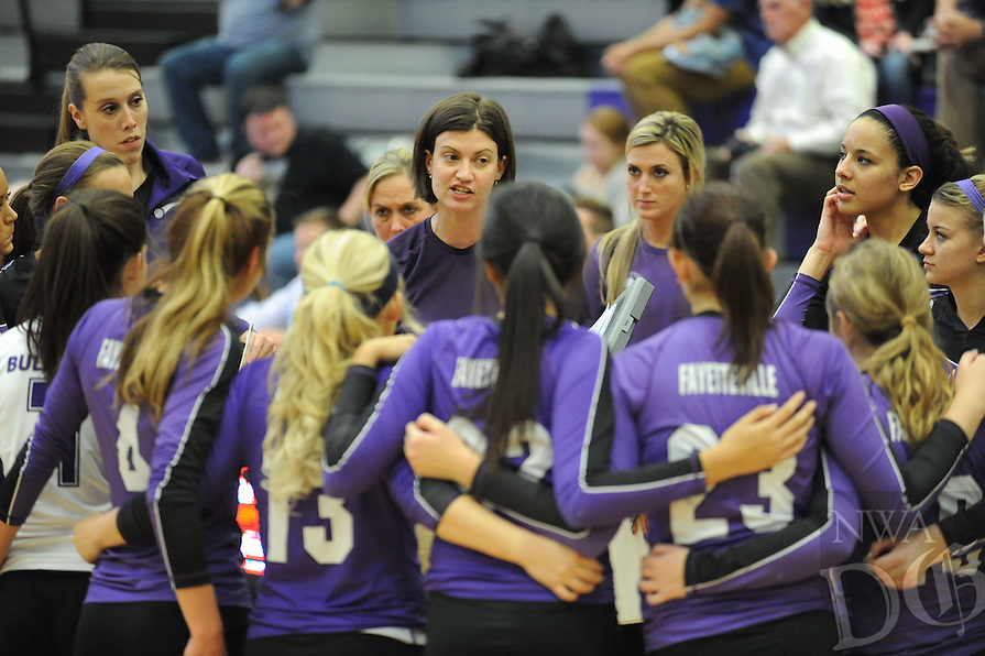 STAFF PHOTO ANDY SHUPE - Fayetteville coach Jessica Phelan directs her team against Fort Smith Southside Thursday, Oct. 30, 2014, during play in the semi-final round of the Class 7A state tournament at Fayetteville High School.