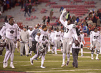 NWA Democrat-Gazette/BEN GOFF @NWABENGOFF<br /> Jamoral Graham (9), Mississippi State defensive back, Deontay Evans (17), defensive back, and Will Coleman (57), defensive lineman, celebrate as they leave the field after defeating Arkansas on Saturday Nov. 21, 2015 during the game in Razorback Stadium in Fayetteville.