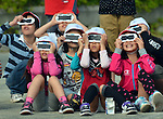 May 21, 2012, Tokorozawa, Japan - Japanese school children use specially designed eye glasses, observing the annular solar eclipse in progress in Tokorozawa, Tokyos western suburbs on Monday, May 21, 2012...From southern Kyushu to Tohoku, northeastern Japan, some 83 million people along the Pacific Coasts observed the rare phenomenon, in which the moon blocks all but a ring of the suns light. In Tokyo, it was viewed for the first time in 173 years. (Photo by Natsuki Sakai/AFLO) AYF -mis-.