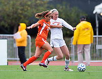 Kim Hutchinson (17) of Miami holds off Shannon McCarthy (8) of Maryland during the game at Ludwig Field in College Park, MD.  Maryland defeated Miami, 2-1, in overtime.
