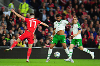 Tom Lawrence of Wales battles with Cyrus Christie of Republic of Ireland during the UEFA Nations League B match between Wales and Ireland at Cardiff City Stadium in Cardiff, Wales, UK.September 6, 2018